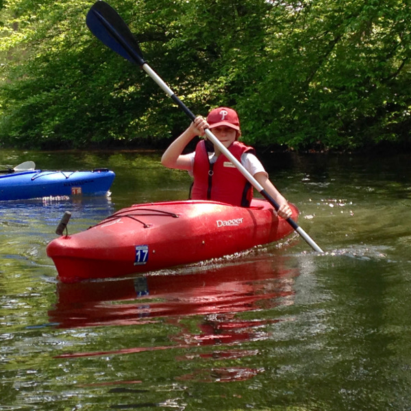 Leah navigating her kayak down the canal
